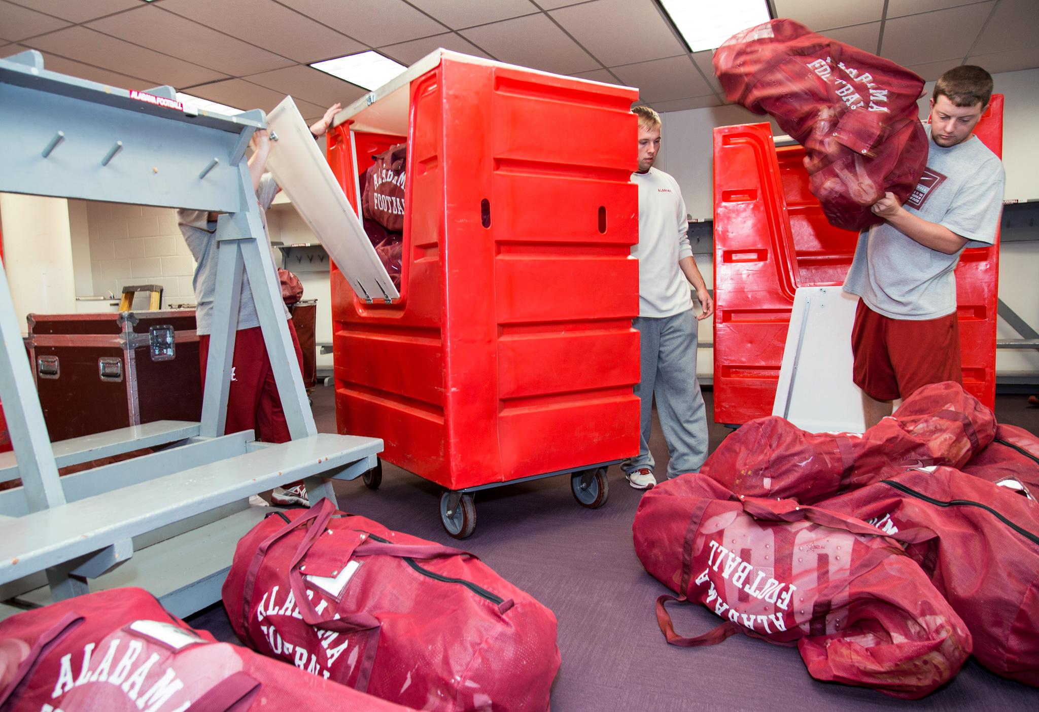 Equipment mangers unload the truck
