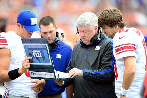 David Carr, Kevin Gilbride and Eli Manning
