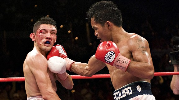 Manny Pacquiao stopped David Diaz in the ninth round to win the lightweight title in 2008.