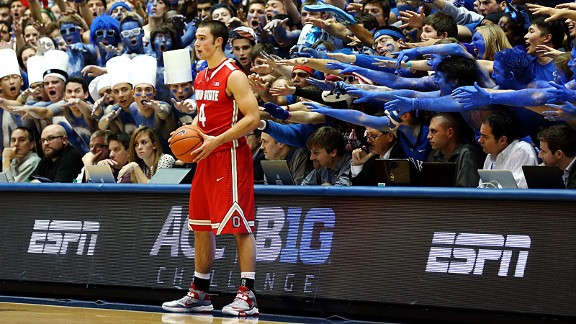 Ohio State's Aaron Craft with the Cameron Crazies of the Duke Blue Devils