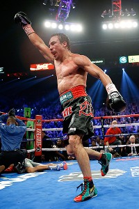 Juan Manuel Marquez celebrates after knocking Manny Pacquiao out in the sixth round. Pacquiao was ahead 47-46 on all three scorecards following the fifth round.