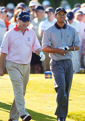 Tiger Woods and Tom Watson
