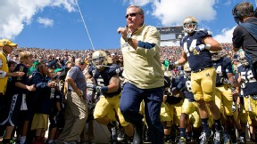 Brian Kelly will be leading the Fighting Irish out of the tunnel against Purdue at Lucas Oil Stadium in Indianapolis next season instead of South Bend.
