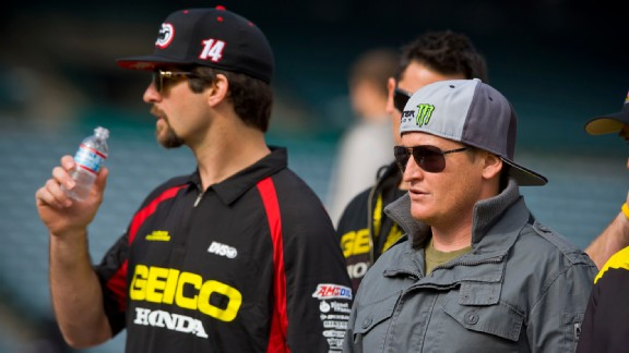 NASCAR star Ricky Carmichael surveys the AMA Supercross racetrack at Angel Stadium in Anaheim with Kevin Windham prior to practice in January 2012.