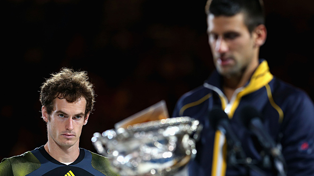 Andy Murray of Great Britain (L) watches Novak Djokovic of Serbia