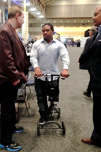 MJD scooting around with three wheels