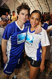 The Vampire Diaries actor Ian Somerhalder poses with Olympian Lolo Jones at the Celebrity Beach Bowl.