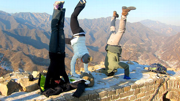 Emily Cook (left) and teammates Allie Lee and Dylan Ferguson on the Great Wall of China. Says Cook, Aerialists like to be upside-down!