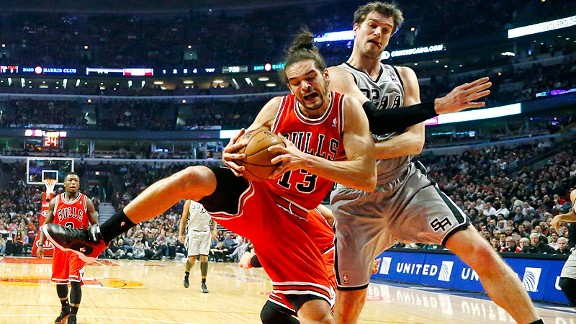 Joakim Noah of the Chicago Bulls and Tiago Splitter of the San Antonio Spurs