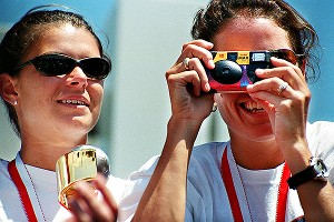 Smile for the camera! Mia Hamm, left, and Julie Foudy.