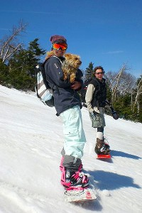 Lindsey Jacobellis with her dog, Gidgit, and father, Ben, snowboarding in Vermont before her ACL injury.