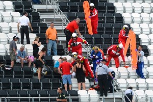 Emergency workers help injured spectators in the upper level of the front grandstand at Daytona International Speedway after a major wreck on the final lap of the Nationwide race.