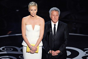 Charlize Theron performed a steamy dance number with Channing Tatum before teaming up with Dustin Hoffman to present the award for Best Adapted Screenplay to Argo.
