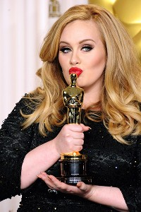 Adele teared up while accepting her award and let the co-author of Skyfall finish up.