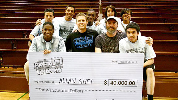 Allan Guei decided not to cash this check for 40,000 for himself. Instead, he shared it with the losers.