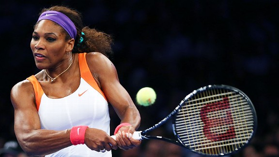 Serena Williams returns a shot during her exhibition match against Victoria Azarenka.