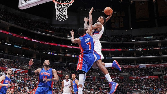 DeAndre Jordan of the Los Angeles Clippers dunking over Brandon Knight of the Detroit Pistons