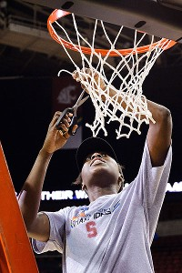 After winning the conference title, Chiney Ogwumike cuts down the nets.