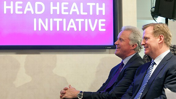 GE CEO Jeff Immelt, left, and Roger Goodell are working to further concussion prevention measures.