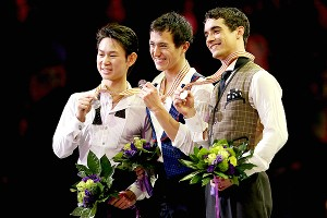 This year's podium winners in the men's event at the World Figure Skating Championships: Denis Ten (silver), left, Patrick Chan (gold), center, and Javier Fernandez (bronze).