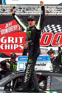 Kyle Busch celebrates after edging Kyle Larson to win the NASCAR Nationwide Series race at Bristol.