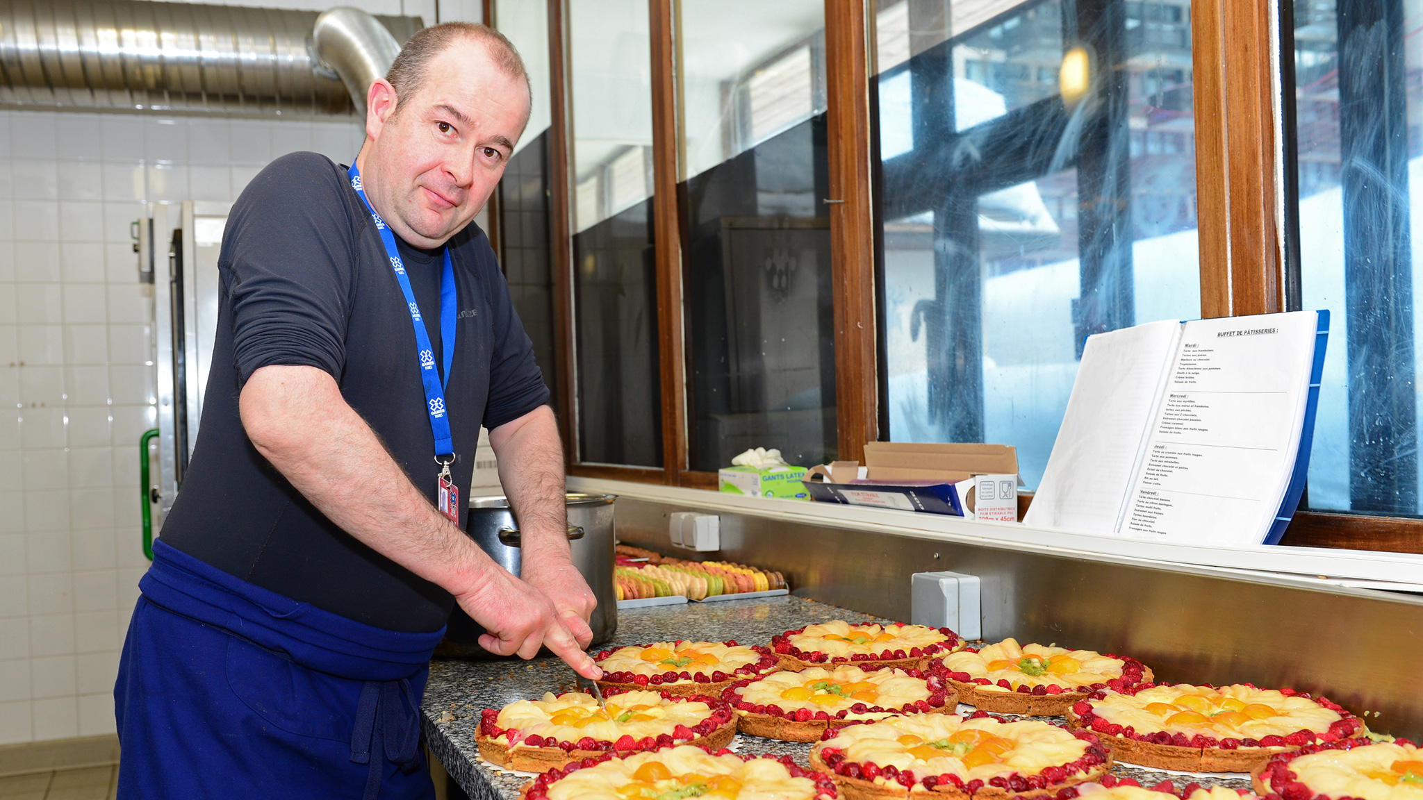 Hotel Diva Patisserie Cook Jean-Charles Gautier slices into a fruit tart at X Games Tignes.