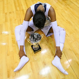 Diamond DeShields sits on the court with the 2012-13 state championship trophy.