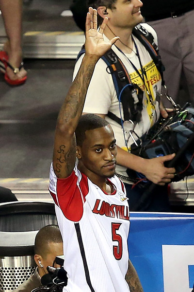 ATLANTA -- Kevin Ware couldn't help but be angry, even as he prayed to God. There he was, leaning over the edge of the raised floor with his broken leg