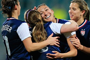 U.S. striker Christen Press (center smiling) and her teammates celebrate after one of her two goals against the Dutch on Tuesday.