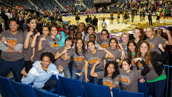 WNBA champion Tamika Catchings meets with emerging female athletes. Catchings recently returned from Thailand, where she and fellow WNBAer Ebony Hoffman led clinics and conversation to empower women and girls in Bangkok.