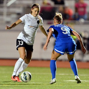 Portland's Alex Morgan (13), the big name on the pitch, makes a move around Kansas City's Merritt Mathias.
