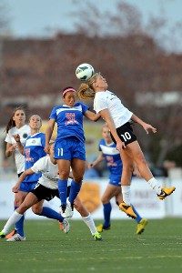 Portland's Allie Long (10) heads the ball against Kansas City's Desiree Scott (11) in the inaugural NWSL match.