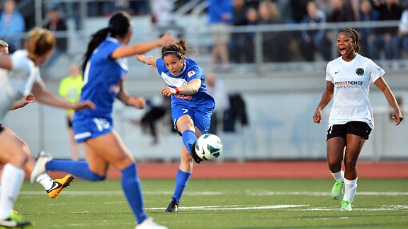 FC Kansas City forward Casey Loyd (7) puts the ball on goal against Portland Thorns FC in the first half.