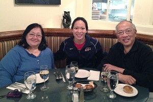 Julie Chu (center) enjoying a meal  with her mother, Miriam, left, and father, Wah.