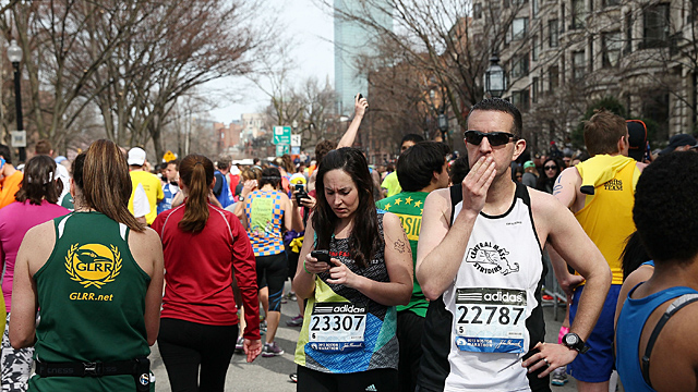 Runners react near Kenmore Square