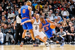 Tyson Chandler, Tony Parker and Raymond Felton