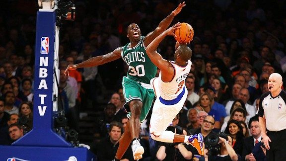 Raymond Felton of the New York Knicks and Brandon Bass of the Boston Celtics