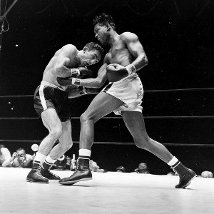 AP Photo Sugar Ray Robinson, right, was defeated on 19 occasions in ...