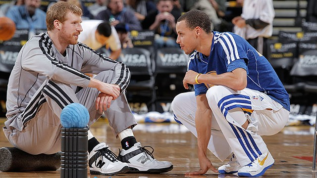 Stephen Curry #30 of the Golden State Warriors talks with Matt Bonner #15 of the San Antonio Spurs on April 15, 2013 at Oracle Arena in Oakland, California.