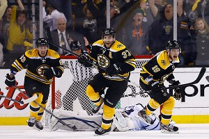 Patrice Bergeron #37, Tyler Seguin #19, and Brad Marchand #63