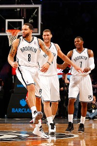 Deron Williams, Brook Lopez and Joe Johnson.
