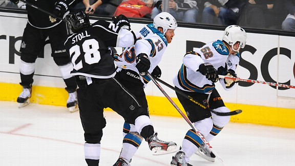 Raffi Torres of the San Jose Sharks hitting Jarret Stoll of the Los Angeles Kings