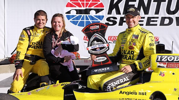 Sarah Fisher, husband Andy O'Gara, daughter Zoey and former driver Ed Carpenter in Victory Lane at Kentucky.