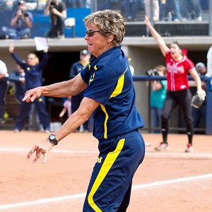 After dropping Game 2, coach Carol Hutchins and Michigan rallied late to beat Louisiana-Lafayette in the deciding game and advance to the World Series.