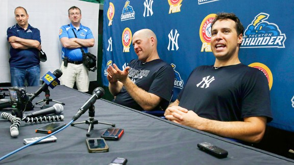 Brian Cashman, Mark Teixeira and Kevin Youkilis