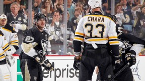 Sidney Crosby of the Pittsburgh Penguins and Zdeno Chara of the Boston Bruins