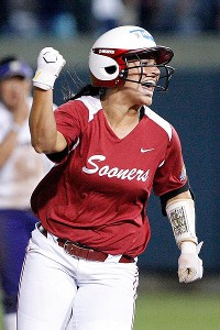 Oklahoma's Lauren Chamberlain celebrates while rounding the bases after her third-inning homer against Washington.