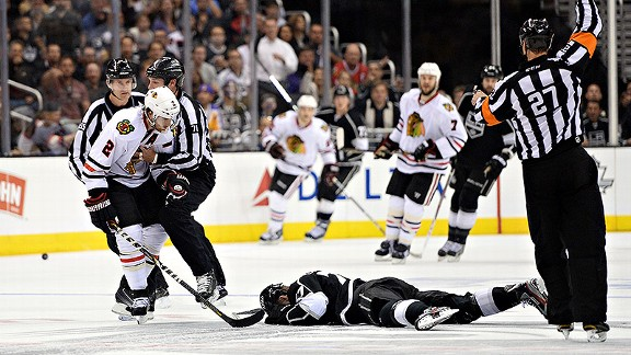 Duncan Keith of the Chicago Blackhawks and Jeff Carter of the Los Angeles Kings