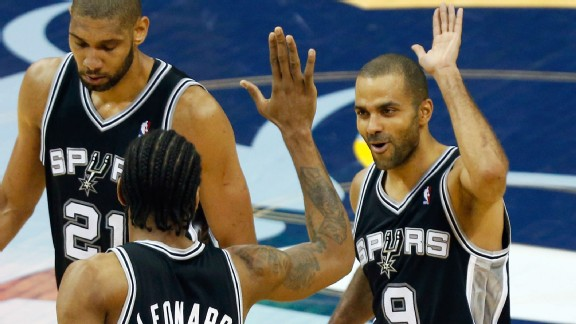 an Antonio Spurs' Kawhi Leonard (2) congratulates teammate Tony Parker (9), of France, after making a basket against the Memphis Grizzlies in overtime during Game 3 of the Western Conference finals NBA basketball playoff series, Saturday, May 25, 2013, in