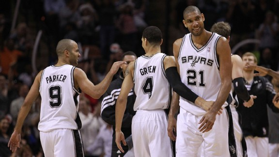 Tony Parker #9, Daniel Green #4 and Tim Duncan #21 of the San Antonio Spurs celebrate during play against the Los Angeles Clippers in Game Two of the Western Conference Semifinals of the 2012 NBA Playoffs at AT&T Center on May 17, 2012 in San Antonio, Tex